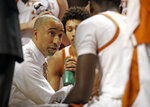 FILE - In this March 4, 2019, file photo, Texas coach Shaka Smart talks to his players on the bench during the first half of an NCAA college basketball game against Texas Tech in Lubbock, Texas. Smart's four seasons with the Longhorns have produced a national tournament championship and three one-and-done first-round NBA draft picks. (AP Photo/Brad Tollefson, File)