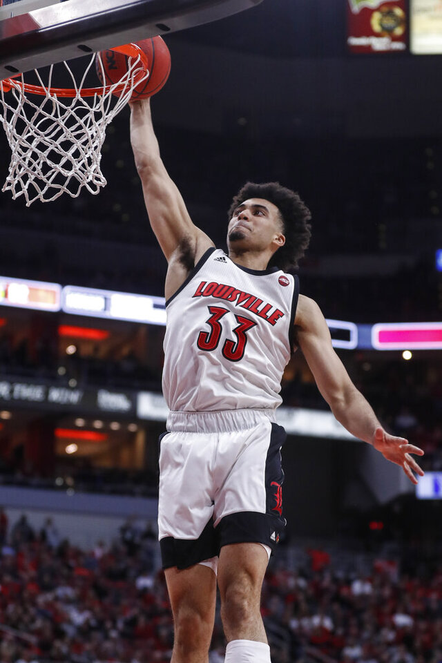 Louisville forward Jordan Nwora (33) dunks the ball during the second half of an NCAA college basketball game against Syracuse Wednesday, Feb. 19, 2020, in Louisville, Ky. Louisville won 90-66. (AP Photo/Wade Payne)