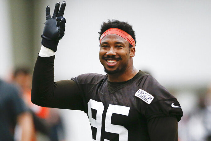 FILE - In this June 6, 2019, file photo, Cleveland Browns defensive end Myles Garrett reacts after a play during practice at the team's NFL football training facility in Berea, Ohio. The Cleveland Browns are closing in on a massive contract extension with Garrett, a person familiar with the negotiations told the Associated Press on Tuesday, July 14, 2020. Garrett, the No. 1 overall pick in 2017 and one of the NFL's premiere edge rushers, and the team could have the deal completed in the next day or so, said the person who spoke on condition of anonymity because of the sensitivity of the talks. (AP Photo/Ron Schwane, File)
