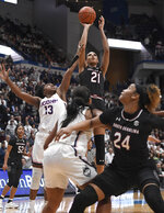 South Carolina's Mikiah Herbert Harrigan (21) makes a basket as Connecticut's Christyn Williams (13) defends during the first half of an NCAA college basketball game, Monday, Feb. 11, 2019, in Hartford, Conn. (AP Photo/Jessica Hill)