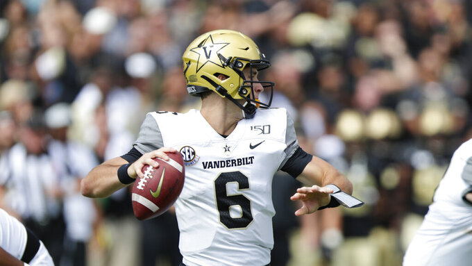 Vanderbilt quarterback Riley Neal (6) throws against Purdue during the first half of an NCAA college football game in West Lafayette, Ind., Saturday, Sept. 7, 2019. (AP Photo/Michael Conroy)