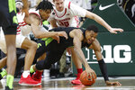 Wisconsin forward Aleem Ford, left, and Michigan State forward Xavier Tillman chase the ball during the first half of an NCAA college basketball game, Friday, Jan. 17, 2020, in East Lansing, Mich. (AP Photo/Carlos Osorio)