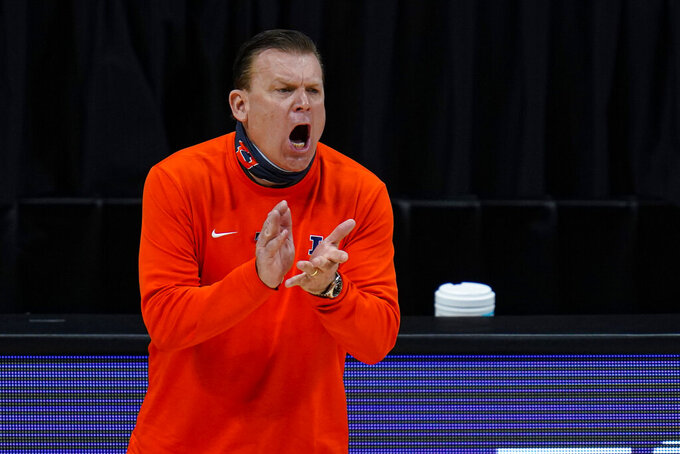 Illinois head coach Brad Underwood yells to his team as they played against Ohio State in an NCAA college basketball championship game at the Big Ten Conference tournament in Indianapolis, Sunday, March 14, 2021. (AP Photo/Michael Conroy)