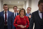 Speaker of the House Nancy Pelosi, D-Calif., arrives to talk to reporters on the morning after the first public hearing in the impeachment probe of President Donald Trump on his effort to tie U.S. aid for Ukraine to investigations of his political opponents, on Capitol Hill in Washington, Thursday, Nov. 14, 2019. Pelosi says the president's actions in the impeachment inquiry amount to