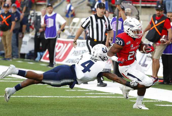 Fresno State running back Ronnie Rivers heads in for a touchdown past Utah State safety Shaq Bond during the first half of an NCAA college football game in Fresno, Calif., Saturday, Nov. 9, 2019. (AP Photo/Gary Kazanjian)
