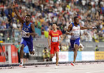Noah Lyles of the United States, left, celebrates after leading the team to gold in the men's 4x100 meter relay final at the World Athletics Championships in Doha, Qatar, Saturday, Oct. 5, 2019. (AP Photo/Petr David Josek)