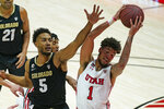 Colorado guard D'Shawn Schwartz (5) defends against Utah forward Timmy Allen (1) who pulls down a rebound in the first half during an NCAA college basketball game Monday, Jan. 11, 2021, in Salt Lake City. (AP Photo/Rick Bowmer)