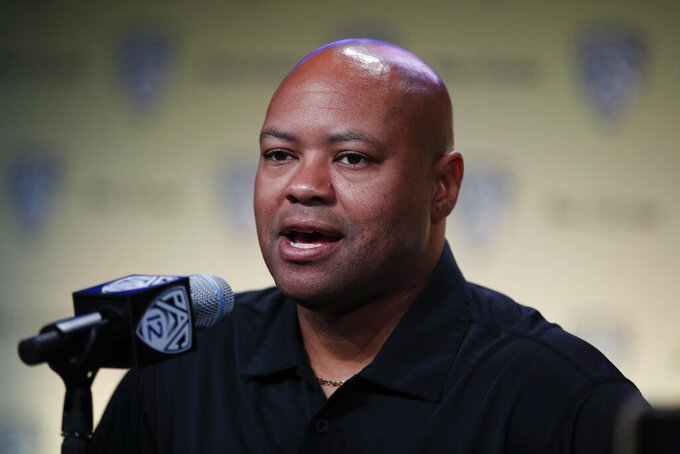 FILE - In this July 25, 2018, file photo, Stanford head coach David Shaw speaks at the Pac-12 Conference NCAA college football Media Day in Los Angeles. The NCAA's Division I Council meets this week in Indianapolis, and it is expected to vote by Friday, April 19, 2019, on an amendment to the rules regarding graduate transfers and financial aid. If passed the proposal would require a grad transfer to count against a team's scholarship total for two years no matter how much eligibility the player has remaining. Shaw, whose program routinely operates below the major-college maximum of 85 scholarship players, said he would not hesitate to bring in a star-level player as a grad transfer even if it meant having an vacant scholarship the next season. But teams could be less inclined to take that hit with a lesser player. (AP Photo/Jae C. Hong, File)