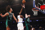 New York Knicks forward RJ Barrett (9) shoots while defended by Boston Celtics forward Gordon Hayward (20) and Celtics guard Carsen Edwards (4) during the first half of an NBA basketball game in New York, Saturday, Oct. 26, 2019. (AP Photo/Kathy Willens)