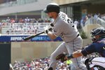 Chicago White Sox's Matt Skole drives in a run on a single off Minnesota Twins pitcher Jake Odorizzi in the first inning of a baseball game Wednesday, Aug. 21, 2019, in Minneapolis. (AP Photo/Jim Mone)