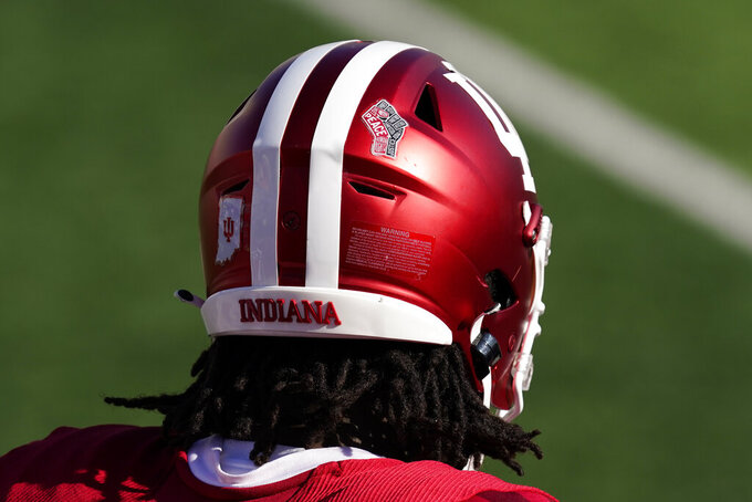 A social justice logo is seen on the helmet of Indiana's Caleb Jones during the first half of an NCCAA college football game against Penn State, Saturday, Oct. 24, 2020, in Bloomington, Ind. (AP Photo/Darron Cummings)