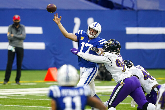 Indianapolis Colts quarterback Philip Rivers (17) is pressured by Baltimore Ravens outside linebacker Matt Judon (99) in the second half of an NFL football game in Indianapolis, Sunday, Nov. 8, 2020. (AP Photo/Darron Cummings)