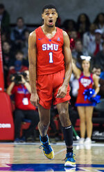 SMU forward Feron Hunt (1) celebrates a three pointer during the first half of an NCAA college basketball game against Connecticut Wednesday, Feb. 12, 2020, in Dallas. (Ashley Landis/The Dallas Morning News via AP)