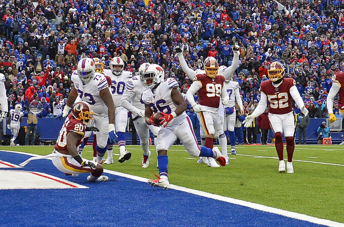 Buffalo Bills running back Devin Singletary (26) rushes for a two-yard touchdown during the second half of an NFL football game against the Washington Redskins, Sunday, Nov. 3, 2019, in Orchard Park, N.Y. (AP Photo/Adrian Kraus)