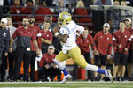 FILE - In this Sept. 21, 2019, file photo, UCLA quarterback Dorian Thompson-Robinson (1) runs with the ball during the second half of an NCAA college football game against Washington State in Pullman, Wash. UCLA rallied from a 32-point deficit in the middle of the third quarter to beat Washington State 67-63 on the road in the highest-scoring Pac-12 game in history. Dorian Thompson-Robinson threw for four touchdowns and ran for two others during the comeback. (AP Photo/Young Kwak, File)