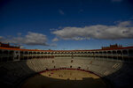 Pupils perform with their capes at the Bullfighting School at Las Ventas bullring in Madrid, Spain, Tuesday, Dec. 29, 2020. Las Ventas is one of the most prized venues in bullfighting, and a privileged place for its pupils to learn. The school was closed from March to August when Spain went into one of the world's strictest confinements to stem the spread of the COVID-19 pandemic. (AP Photo/Manu Fernandez)