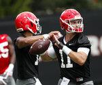 Georgia quarterback Jake Fromm (11) throws during their NCAA college football training camp practice Friday, Aug. 3, 2018 in Athens, Ga. (AP Photo/John Bazemore)