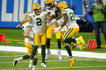 Green Bay Packers kicker Mason Crosby (2) celebrates his field goal with teammate during the second half of an NFL football game against the Detroit Lions, Sunday, Dec. 13, 2020, in Detroit. (AP Photo/Paul Sancya)