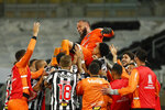 Players of Brazil's Atletico Mineiro celebrate after beating Argentina's Boca Juniors on penalty shootout during a Copa Libertadores round of 16 second leg soccer match in Belo Horizonte, Brazil, Tuesday, July 20, 2021. (AP Photo/Bruna Prado, Pool)