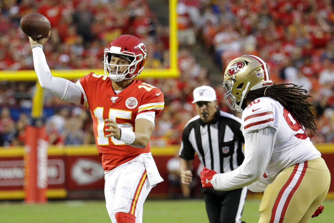 Kansas City Chiefs quarterback Patrick Mahomes (15) throws as San Francisco 49ers defensive tackle Sheldon Day (96) closes in during the first half of an NFL preseason football game in Kansas City, Mo., Saturday, Aug. 24, 2019. (AP Photo/Charlie Riedel)