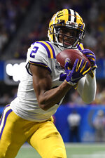 FILE - In this Dec. 28, 2019, file photo, LSU wide receiver Justin Jefferson (2) makes a touchdown catch against Oklahoma during the first half of the Peach Bowl NCAA semifinal college football playoff game, in Atlanta. LSU's Joe Burrow and Justin Jefferson were easy selections for The Associated Press all-bowl team. The two connected for four first-half touchdowns in a College Football Playoff semifinal blowout of Oklahoma. (AP Photo/Danny Karnik, File)