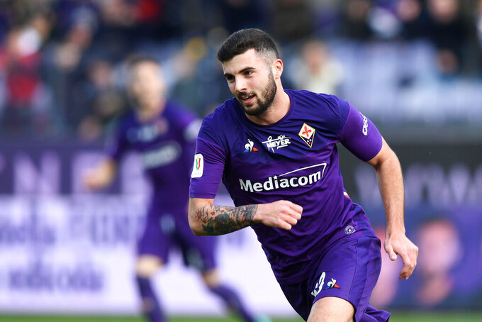 "FILE - In this Wednesday, Jan. 15, 2020. filer, Fiorentina's Patrick Cutrone celebrates after scoring his side's first goal during an Italian Cup eightfinal soccer match, between Fiorentina and Atalanta at the Artemio Franchi stadium in Florence, Italy. Two more Fiorentina players have tested positive for COVID-19 as well as a club physiotherapist. The top-tier Italian league team tweets that defender and club captain Germán Pezzella, forward Patrick Cutrone and physiotherapist Stefano Dainelli ""are in good health at their homes in Florence. For most people, the new coronavirus causes only mild or moderate symptoms. For some, it can cause more severe illness, especially in older adults and people with existing health problems.(Jennifer Lorenzini/LaPresse via AP, File)"