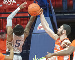 Illinois forward Giorgi Bezhanishvili, right, and Penn State' guard Jamari Wheeler (5) vie for the ball during the first half of an NCAA college basketball game in Champaign, Ill., Saturday, Feb. 23, 2019.(AP Photo/Robin Scholz)