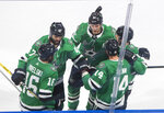 Dallas Stars center Joe Pavelski (16) celebrates his goal against the Tampa Bay Lightning with teammates during the first period of Game 4 of the NHL hockey Stanley Cup Final, Friday, Sept. 25, 2020, in Edmonton, Alberta. (Jason Franson/The Canadian Press via AP)