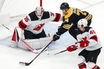 Boston Bruins' Jake DeBrusk (74) tries to shoot against New Jersey Devils' Cory Schneider (35) during the second period of an NHL hockey game in Boston, Saturday, Oct. 12, 2019. (AP Photo/Michael Dwyer)
