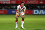 Catalans Dragons Israel Folau restarts play during the Super League rugby match between Catalans Dragons and Castleford Tigers at Stade Gilbert Brutus in Perpignan, France, Saturday, Feb. 15, 2020. (AP Photo/Joan Monfort)