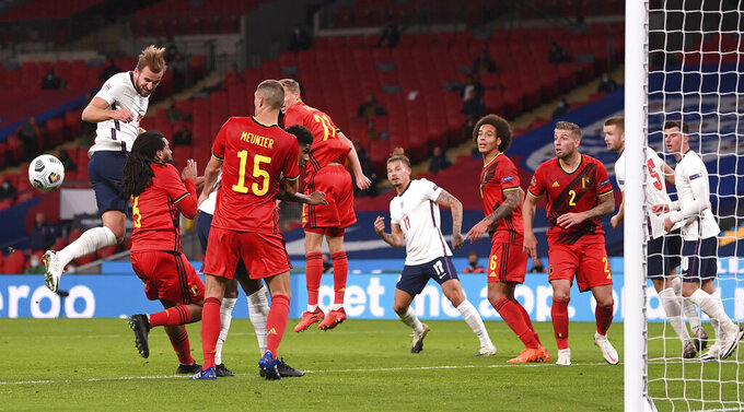 England's Harry Kane, left, misses a chance to score during the UEFA Nations League soccer match between England and Belgium at Wembley stadium in London, Sunday, Oct. 11, 2020. (Michael Regan/Pool via AP)