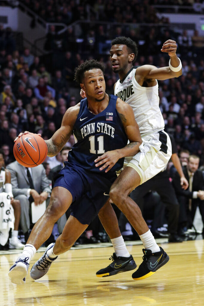 Penn State forward Lamar Stevens (11) drives past Purdue forward Aaron Wheeler (1) during the first half of an NCAA college basketball game in West Lafayette, Ind., Tuesday, Feb. 11, 2020. (AP Photo/Michael Conroy)
