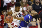 Indiana's Al Durham (1) is called for a charging foul against South Dakota State's Brandon Key (0) during the second half of an NCAA college basketball game, Saturday, Nov. 30, 2019, in Bloomington, Ind. (AP Photo/Darron Cummings)