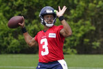 Seattle Seahawks quarterback Russell Wilson passes during NFL football practice Tuesday, June 8, 2021, in Renton, Wash. (AP Photo/Ted S. Warren)