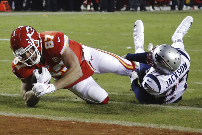 Kansas City Chiefs tight end Travis Kelce (87) makes a touchdown reception against New England Patriots defensive back J.C. Jackson (27) during the second half of the AFC Championship NFL football game, Sunday, Jan. 20, 2019, in Kansas City, Mo. (AP Photo/Elise Amendola)