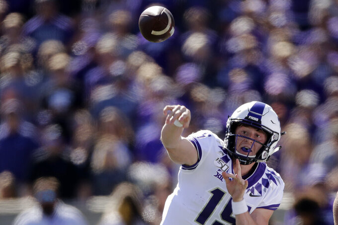 FILE - In this Oct. 19, 2019, file photo, TCU quarterback Max Duggan passes during the first half of an NCAA college football game against Kansas State in Manhattan, Kan. Duggan and Alan Bowman have come back throwing strong again in the Big 12 after both experienced different health issues. Duggan never had any symptoms or problems from a previously undetected lifelong heart issue that was not discovered until the TCU quarterback was going through enhanced COVID-19 protocols as part of preseason testing. (AP Photo/Charlie Riedel, File)