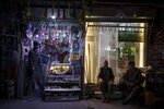 Vendors wait for customers outside their shop in Kabul, Afghanistan, Saturday, Sept. 11, 2021. (AP Photo/Felipe Dana)