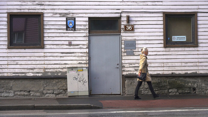 A woman walks past a methadone treatment center in Estonia's capital Tallinn on Friday, June 28, 2019. The tiny Baltic state has battled nearly two decades a fentanyl epidemic so severe its overdose death rate was almost six times the European average. Although police won the war on fentanyl the market shifted further towards synthetic drugs. (AP Photo/David Keyton)