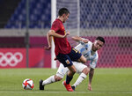 Spain's Pedri Gonzalez, left, and Argentina's Esequiel Barco battle for the ball during a men's soccer match at the 2020 Summer Olympics, Wednesday, July 28, 2021, in Saitama, Japan. (AP Photo/Martin Mejia)