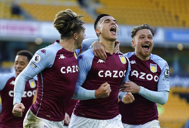 Aston Villa's Anwar El Ghazi, center, celebrates scoring their first goal with Matty Cash, right, and Jack Grealish during the English Premier League soccer match between Wolverhampton and Aston Villa at Molineux Stadium in Wolverhampton, England, Saturday, Dec. 12, 2020. (Tim Keeton/Pool via AP)