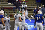 Tulane tight end Tyrick James (80) celebrates a touchdown in the second half of the team's NCAA college football game against Tulsa in Tulsa, Okla., Thursday, Nov. 19, 2020. (AP Photo/Sue Ogrocki)