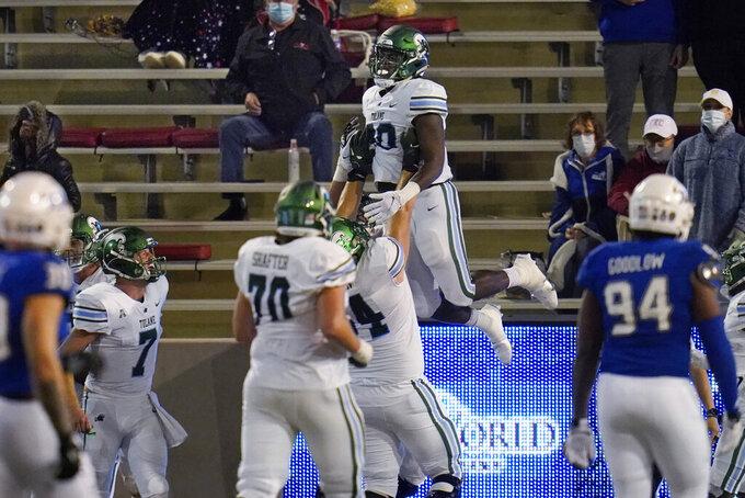 Tulane tight end Tyrick James (80) celebrates a touchdown in the second half of the team's NCAA college football game against Tulsa in Tulsa, Okla., Thursday, Nov. 19, 2020. (AP Photo/Sue Ogrocki)