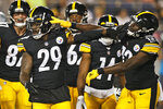 Pittsburgh Steelers running back Kalen Ballage (29) celebrates with wide receiver James Washington (13) after Ballage scored a 4-yard touchdown during the second half against the Dallas Cowboys in the Pro Football Hall of Fame NFL preseason game Thursday, Aug. 5, 2021, in Canton, Ohio. (AP Photo/Ron Schwane)