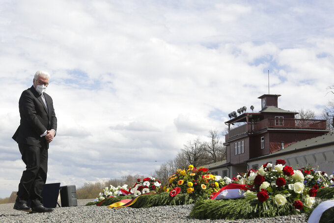 German President Frank-Walter Steinmeier lays down a wreath during commemorations marking the 76th anniversary of the liberation of the Nazi concentration camp Buchenwald near Weimar, Germany, Sunday, April 11, 2021. On April 11, 1945 the US Army liberated the concentration camp Buchenwald. (AP Photo/Markus Schreiber)