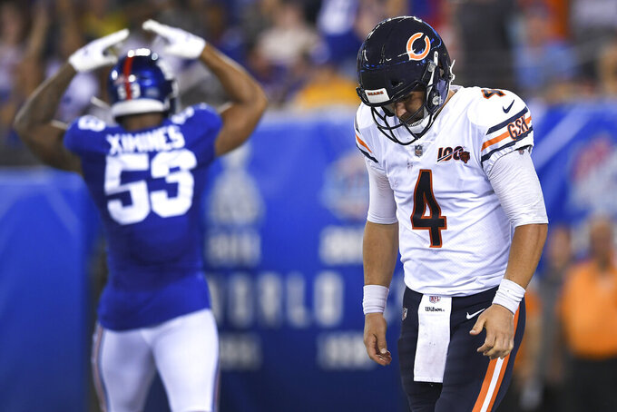 Chicago Bears quarterback Chase Daniel (4) reacts after fumbling the ball and recovering it in the end zone for a safety during the second quarter of a preseason NFL football game against the New York Giants, Friday, Aug. 16, 2019, in East Rutherford, N.J. (AP Photo/Sarah Stier)