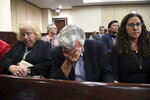 Dan Markel's father, Phil Markel, is overcome with emotion Friday, Oct. 11, 2019, in Tallahassee, Fla., as the guilty verdict is read for Sigfredo Garcia. He and his wife, Ruth Markel, and their daughter, Shelly Markel, remained silent as jurors announced their decision. (Alicia Devine/Tallahassee Democrat via AP)