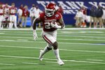 Oklahoma running back Rhamondre Stevenson carries the ball in the second half of the team's Cotton Bowl NCAA college football game against Florida in Arlington, Texas, Wednesday, Dec. 30, 2020. (AP Photo/Ron Jenkins)