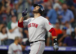 Boston Red Sox's J.D. Martinez gestures as he crosses home plate after hitting a two-run home run off Colorado Rockies starting pitcher Peter Lambert in the top of the third inning of a baseball game Wednesday, Aug. 28, 2019, in Denver. (AP Photo/David Zalubowski)