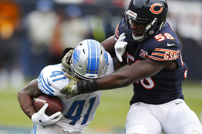 Chicago Bears inside linebacker Roquan Smith (58) grabs the face mask of Detroit Lions running back J.D. McKissic (41) during the first half of an NFL football game in Chicago, Sunday, Nov. 10, 2019. (AP Photo/Charlie Neibergall)