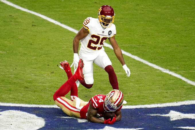 San Francisco 49ers wide receiver Kendrick Bourne (84) makes a catch for a first down as Washington Football Team cornerback Kendall Fuller (29) defends during the first half of an NFL football game, Sunday, Dec. 13, 2020, in Glendale, Ariz. (AP Photo/Ross D. Franklin)